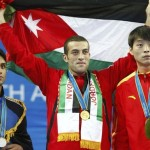 Jordan's Nabil Hassan stands with other medalists after the taekwondo men's under 80kg final at the 16th Asian Games in Guangzhou