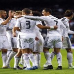 Real Madrid's Ronaldo celebrates his third goal against Celta Vigo with teammates during their Spanish First Division soccer match in Madrid