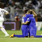 Kuwait's players celebrate their team's goal against Iraq during their Gulf Cup soccer match in Riyadh