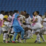 Ghana's players celebrate after winning their African Nations Cup semi-final soccer match against hosts Equatorial Guinea in Malabo