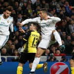 Soccer Football - Champions League - Real Madrid vs Borussia Dortmund - Santiago Bernabeu, Madrid, Spain - December 6, 2017   Real Madrid's Cristiano Ronaldo and Borja Mayoral in action with Borussia Dortmund's Raphael Guerreiro    REUTERS/Juan Medina